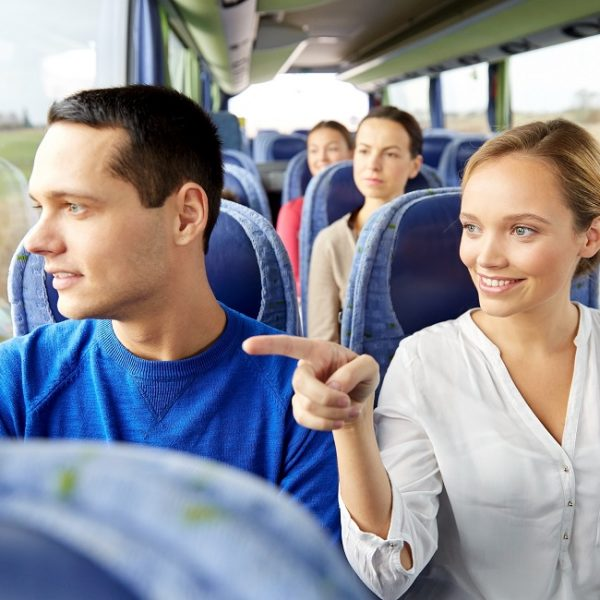 Happy,Couple,Or,Passengers,In,Travel,Bus