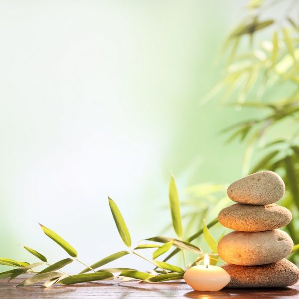 Spa,Still,Life,With,Stacked,Of,Stone,burning,Candle,And,Bamboo